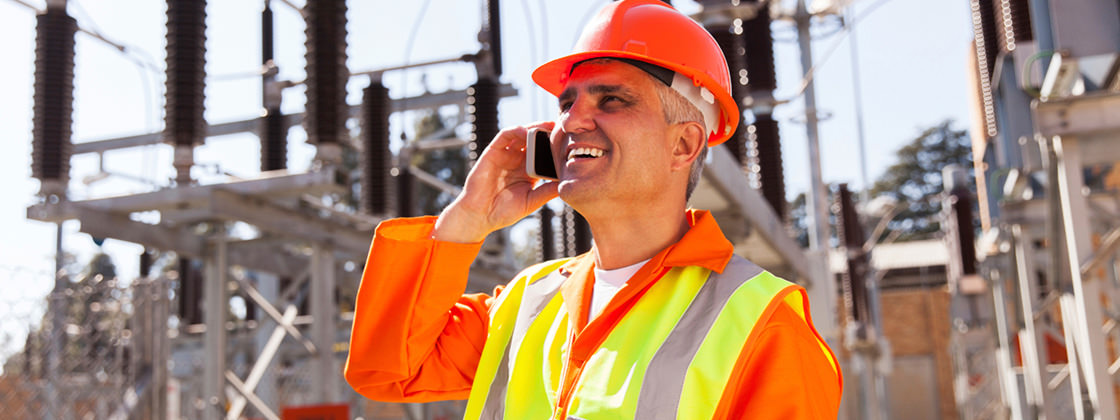 Engineer talking on cell phone - Business Intelligence for the Energy and Utility Industry