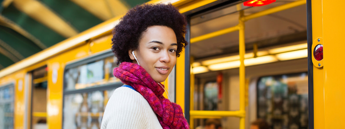 Young woman using public transport - Business Intelligence for Public Transport