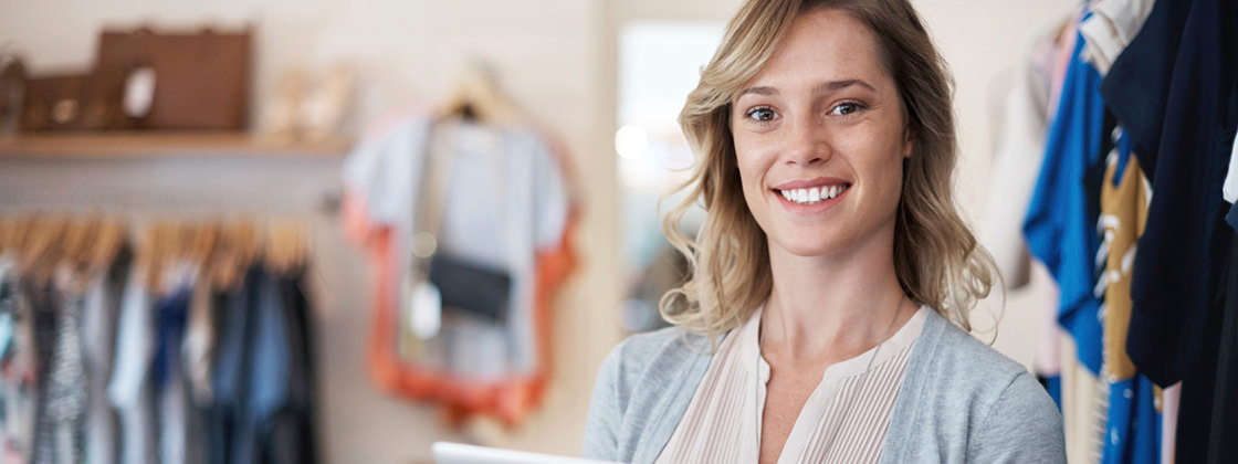 Shop owner holding digital tablet - Business Intelligence for the Retail Industry
