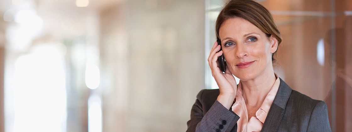 Contact us - Business woman on the telephone