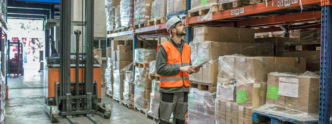 Warehouseman working with tablet in warehouse - Mobile Solution for Microsoft Dynamics NAV
