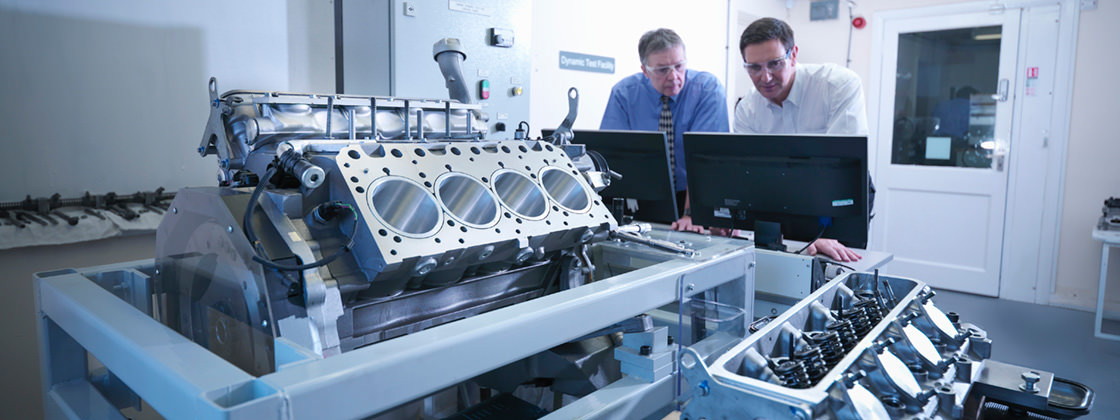 Two automotive engineers analysing data - ERP for the Automotive Supply Industry