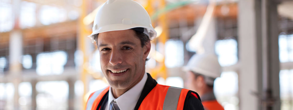 Businessman at construction site - ERP for Main Contractors in the Building Industry
