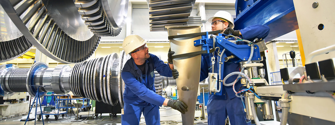 Technicians mounting a turbine - ERP for mechanical engineering