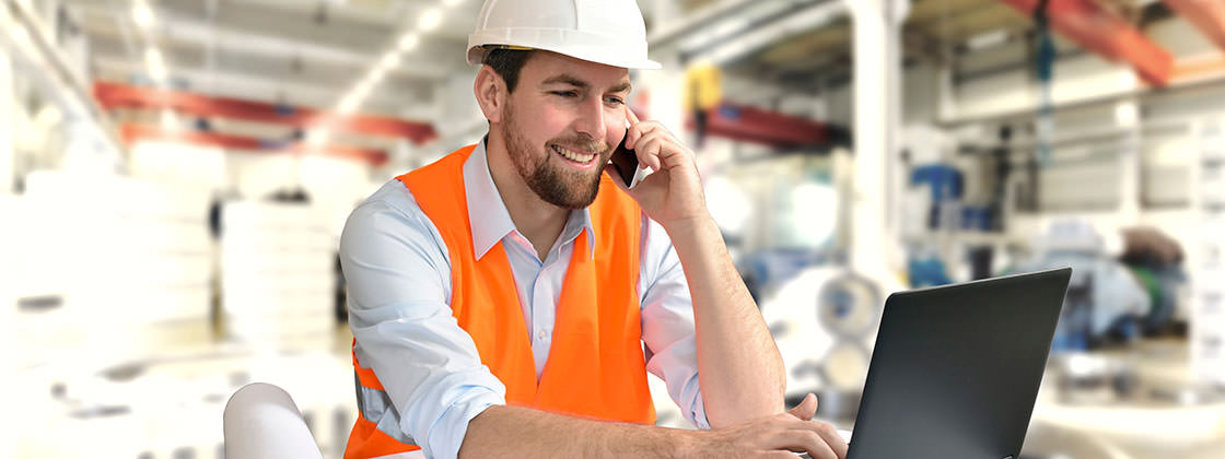 ERP for Project Manufacturing - Engineer using mobile device and laptop