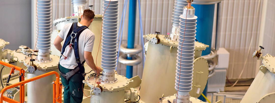 Service technician inspecting a transformer - Service Management with Microsoft Dynamics AX